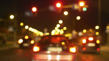 Cars riding on the road at night