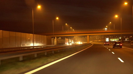 Automobiles riding on highway at night