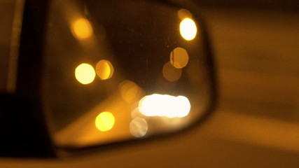 View of wing mirror at night