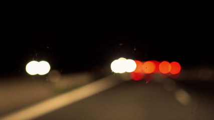 Blurred view of highway and cars at night