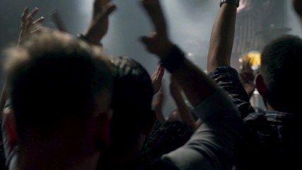 People applaud band at rock concert in the club
