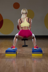 Sexy Woman Performing Dumbbell Barbell Squats