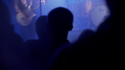 People listening rock star on concert in the club