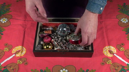 opening vintage wooden box with Christmas New Year retro toys