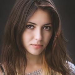 Portrait of a beautiful brunette. Color toned.