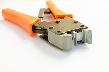 Crimping tool for twisted pair on a white background, isolated