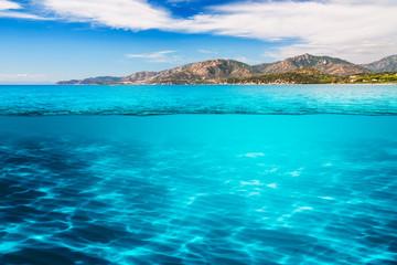 crystal clear mediterranean sea under the blue sky