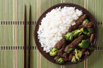 beef with broccoli and rice close-up. horizontal top view