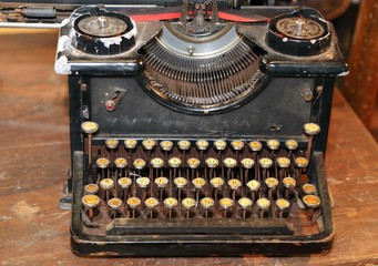 ancient black rusty typewriter used by typists than once