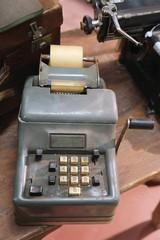ancient mechanical calculator manual with worn keys