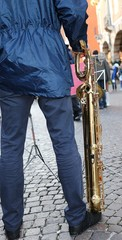 standing band player and sax