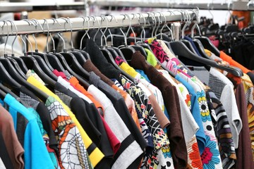vintage clothes of many colors for sale at flea market