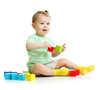 baby playing with colorful wood building blocks isolated