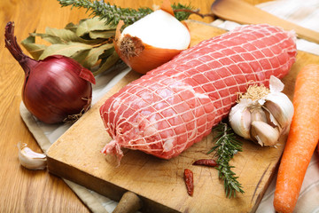Veal roll ready to cook on a cutting board