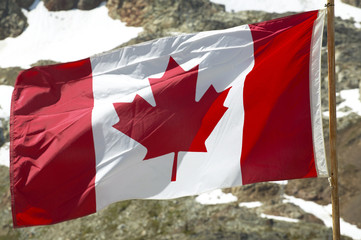 Canadian flag with mountain background. British Columbia. Canada