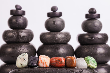 Row Of Chakra Crystals on hot massage stones