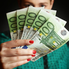 Woman holding euro bills