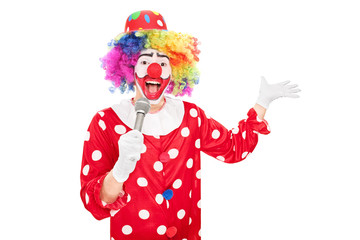 Male clown speaking on a microphone