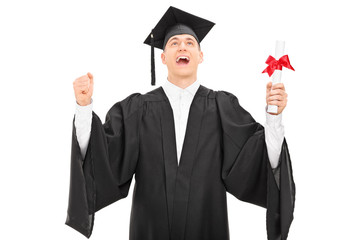 Overjoyed graduate student holding a diploma