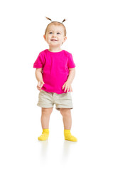 standing baby girl in tshirt isolated