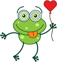 Green frog holding a red heart balloon and feeling in love