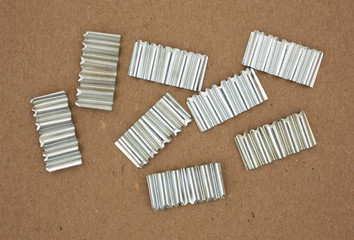 Corrugated joint fasteners on cardboard