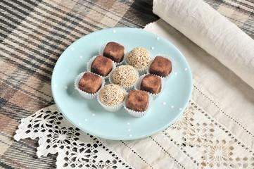 Nine vegetarian candies on blue plate