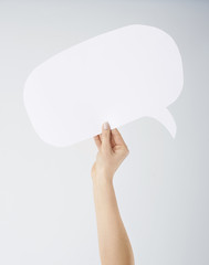 Hand holding empty speech bubble