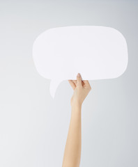Close up of woman's hand with speech bubble