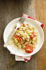 Warm quinoa salad with chickpeas and tomatoes