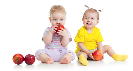 Baby boy and girl eating healthy food isolated