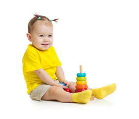 funny baby playing with colorful wood pyramid isolated