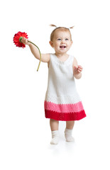 Adorable baby girl walking with flower isolated