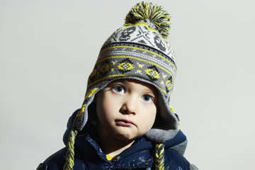 child with blue eyes.fashion kids.little boy in winter cap