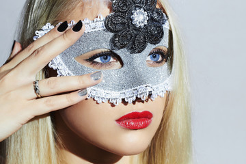Beautiful Blond Young Woman in Carnival Mask.Girl with Manicure