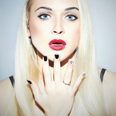 Beautiful blond Woman with Manicure.Sexy Beauty Girl.Make-up