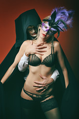 Beautiful woman and mysterious masked man
