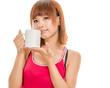 Asian woman with white coffee mug