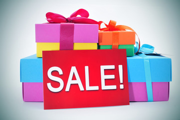 gifts and a red signboard with the word sale