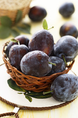 Fresh plums in basket