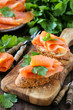 Smoked salmon canape garnished with a fresh parsley leaf