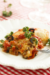 Baked fish with olives, herbs and tomatoes