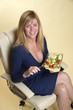 Woman in a blue dress eating takeaway cold food