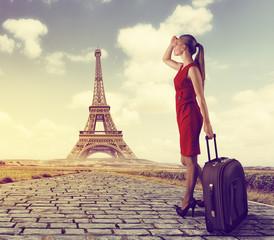 Glamour female traveler looking up for transportation