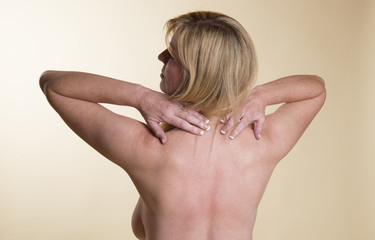 Woman suffering neck pain