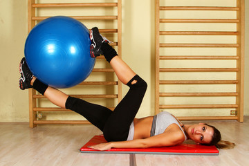 Fitness training with pilates ball