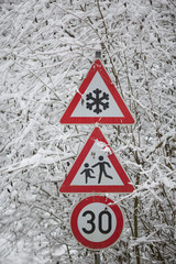 winter warning signs shows danger of ice and snow at street