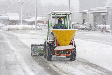 Snow plow removing snow