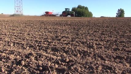 agriculture tractor on autumn farm field seeding  grains