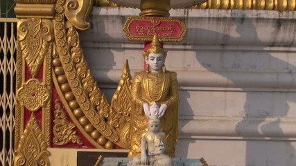 ornate buddhists statue near temple, Kushinagar, India